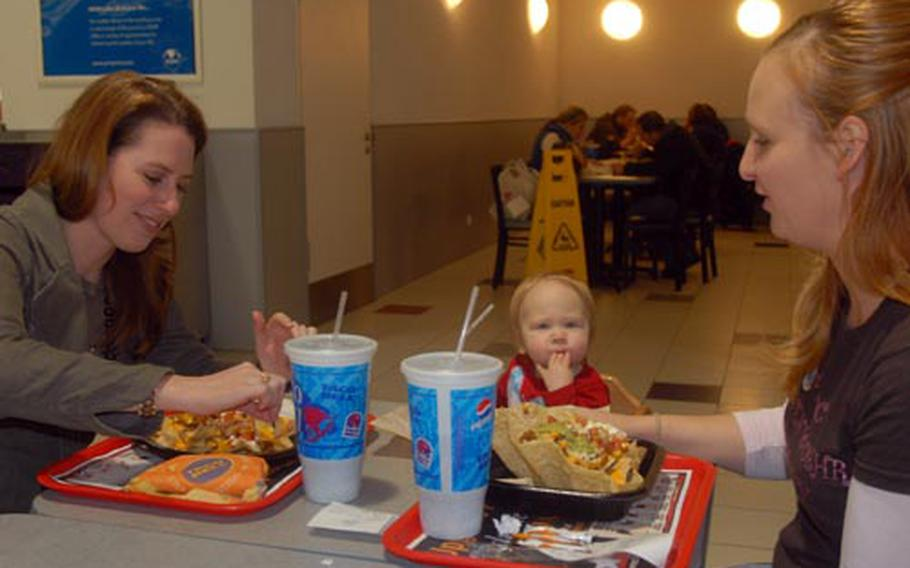 Grafenwöhr military spouses Haila Hill, left, and Jennifer Berlin share lunch with Jennifer's daughter, Makayla, 14 months, at the Grafenwöhr Post Exchange on Thursday.