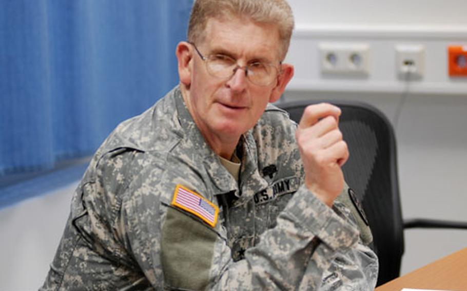 Lt. Gen. Eric Schoomaker, the Army surgeon general, talks with doctors at Landstuhl Regional Medical Center in Germany on Thursday afternoon. Schoomaker visited Army installations in Italy and Germany during his three-day trip.