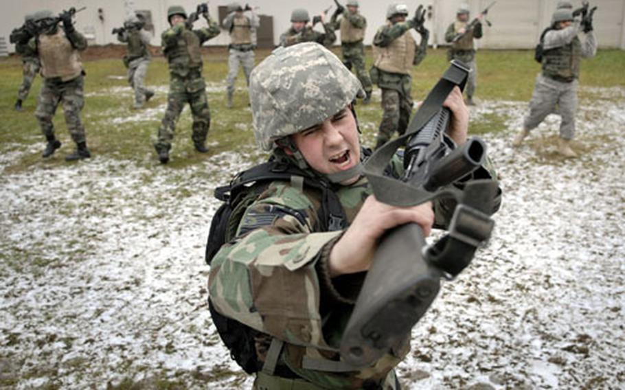 """Air Force Staff Sgt. Jesse Reddam, assigned to the 86th Maintenance Squadron, practices the """"smash"""" move along with other combat skills classmates during the rifle fighting portion of the course Thursday at Ensiedlerhof Air Station in Kaiserslautern, Germany."""