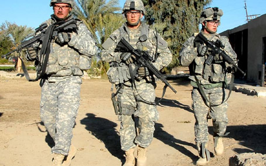 From left, Staff Sgt. Chad Kramer, 2nd Lt. Kevin Mussman and Pvt. Kenneth Eatinger search a farm where an al-Qaida suspect was thought to be hiding.