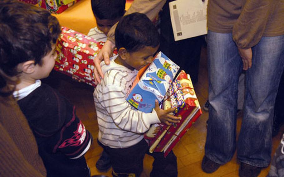 A youngster from Stuttgart struggles to carry all of his presents