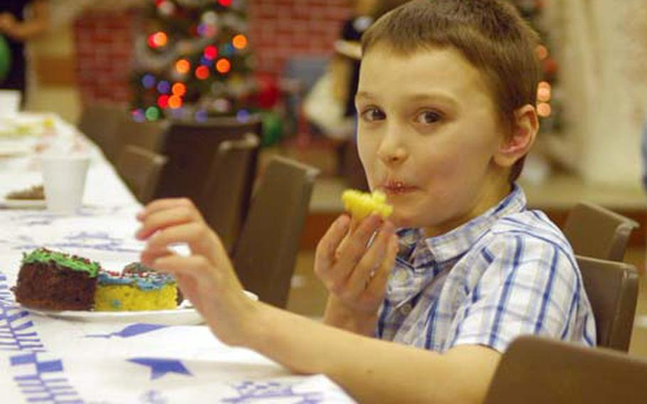 Jordan, an 8-year-old attending the event, enjoys some cake.
