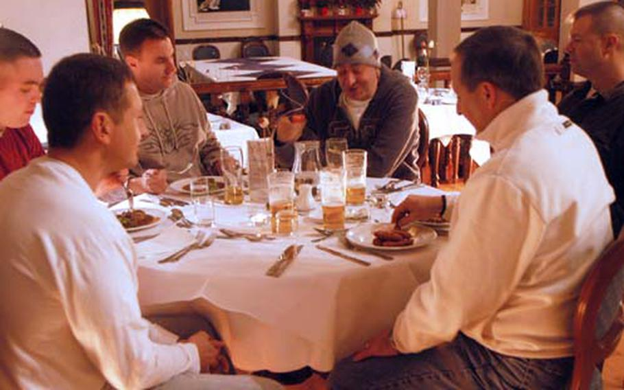 Sailors from Naval Station Norfolk in Virginia have a meal at La Rochelle.