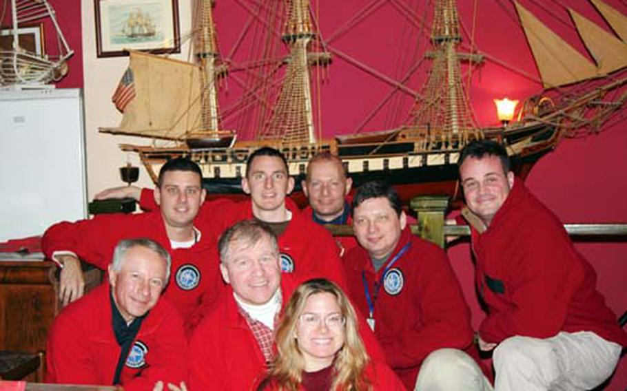 Team members pose for a photo. They are, front, from left, Jan Chrypinski, Kip Karl and Navy Reservist Lt. Sandra Salvatori; middle, from left, Army Capt. Al Eckart, Navy Lt. Brian Moore, Ralph Belander and Navy Reservist Lt. Stuart Gold; and back, Court Rawson.