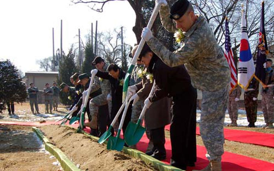 Officials from U.S. Forces Korea and the Republic of Korea/U.S. Friendship Society prepare to turn ceremonial shovels full of dirt Tuesday during the groundbreaking ceremony for a statue of Gen. Walton Walker at Yongsan Garrison.