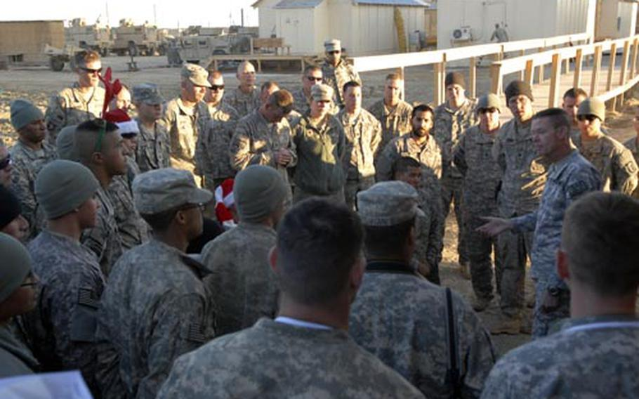 Maj. Gen. Jeffrey Schloesser, right, addressed troops at Combat Outpost Kushmand in southeastern Afghanistan on Christmas. Schloesser praised the troops' work but warned them not to get complacent as their yearlong deployment begins to wind down.