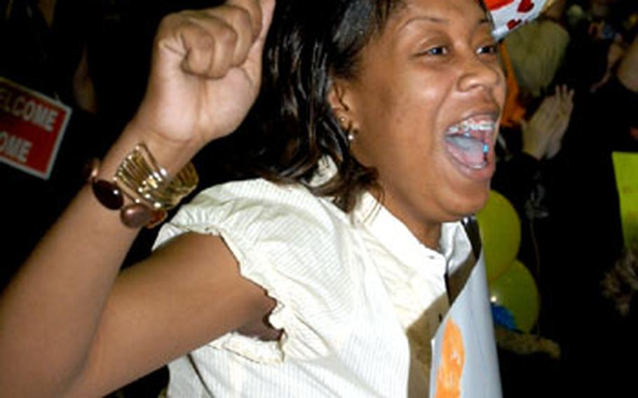 Kishara Allen screams for joy as she sees her husband, Spc. Lacy Thompson Jr. Thompson and around 200 other soldiers came home on Christmas Day from a 15-month Iraq deployment with the 44th Expeditionary Signal Battalion.
