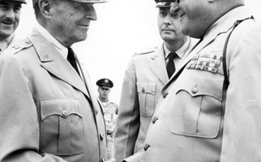 Among the famous people photographed by Sandy Colton during his time at Stripes was Gen. Douglas MacArthur, here being greeted at Yokota Air Base, Japan, in 1961.