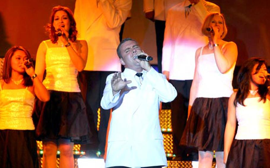 Senior Airman Nicholas Amari leads a performance during a Tops In Blue show Friday at Yokota.