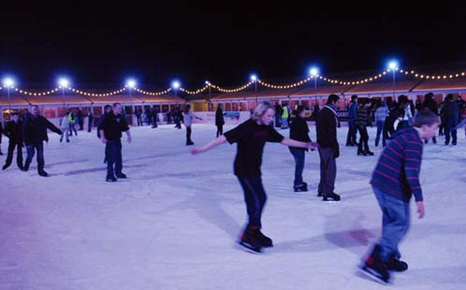 Skaters enjoy the rink at Cambridge on Ice, which runs through Sunday.