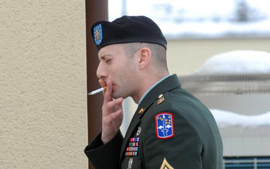 Sgt. Michael Leahy Jr. smokes a cigarette during a recess in his court-martial at Vilseck, Germany, for the alleged murder of detainees in Iraq.