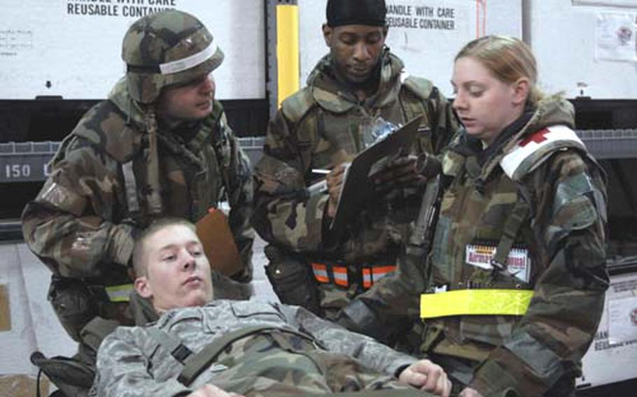 Members of the 8th Medical Group evaluate a patient Wednesday during an operational readiness exercise at Kunsan Air Base, South Korea.