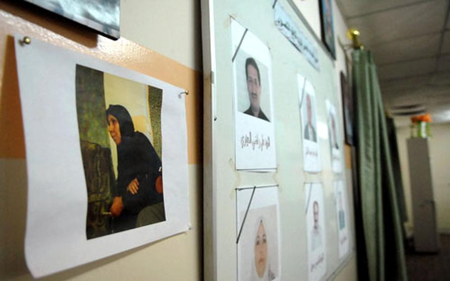 Photos of council members killed during Iraq's fighting line the walls of the Mansour District Council building.