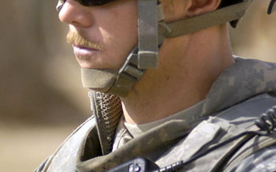 Sgt. 1st Class David Jones, assigned to Task Force 3-66 Armor, waits for a patrol to kick off at Patrol Base Tahweela. Combat 'staches have become a growing trend for many in Task Force 3-66 Armor.
