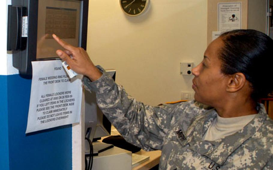 Command Sgt. Maj. Carlin Murphy of the 14th Transportation Battalion, signs in at the fitness center at Caserma Ederle in Vicenza, Italy, using the RecTrac system being used at some MWR facilities in Europe.