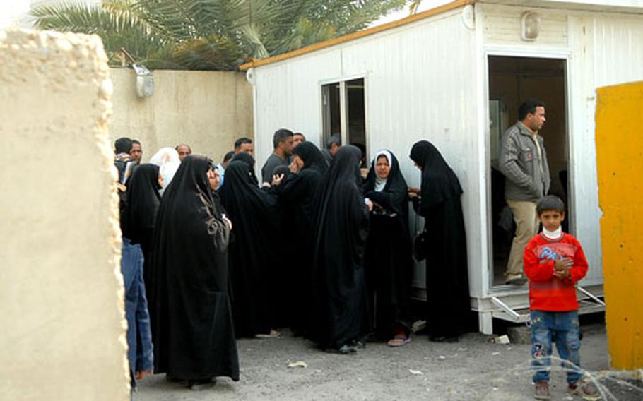 A crowd gathers at the entrance to the Mansour District Council building Jan. 19. Councils are becoming the one-stop shops for people to find out what's going on in their community.