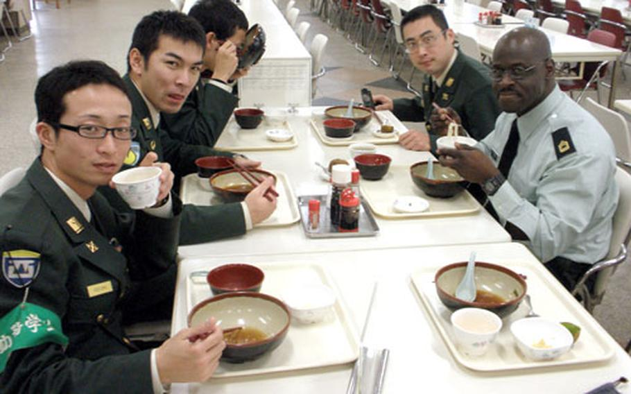 Master Sgt. Frederick Moore enjoys a Japanese lunch with members of the Japan Ground Self-Defense Force last month at Camp Kodaira.