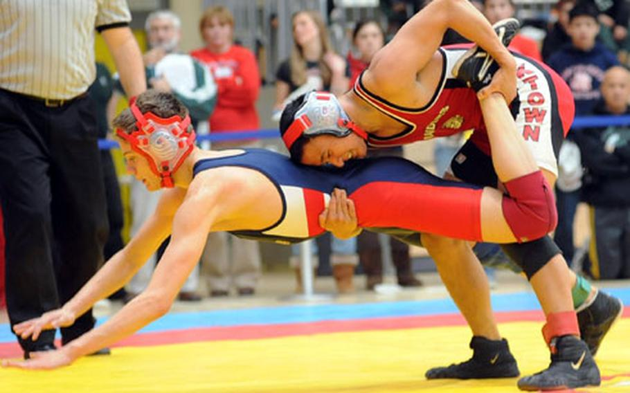 Kaiserslautern's Allin Pangilinan, right, has Searle in a bad spot in their second-round, 119-pound match at the DODDS-Europe wrestling finals in February. Searle was able to turn the tables for the win.