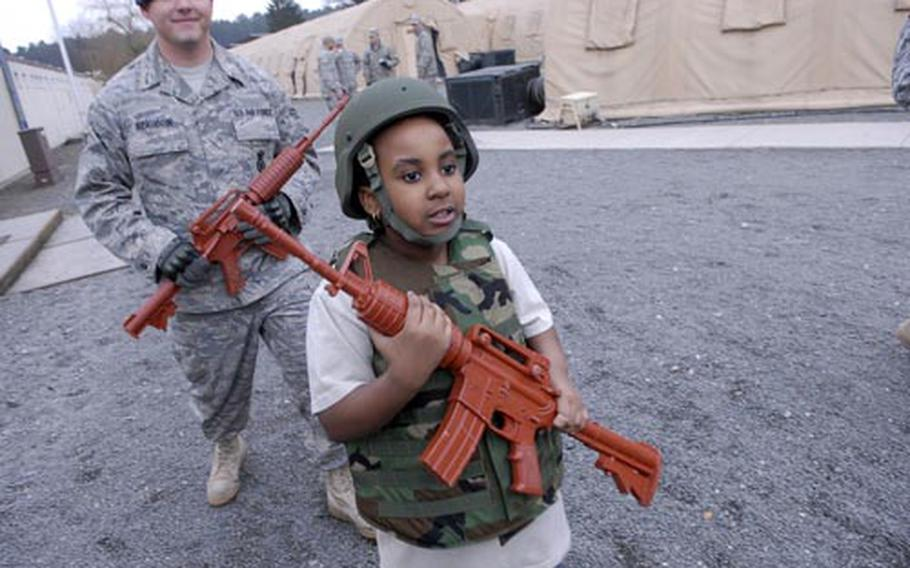 Ramstein Intermediate School fourth-grader Olivia Mitchell, 9, marched with combat gear.