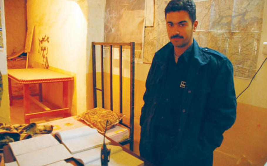 First Lt. Yousif Suri Hamad stands in Rutbah's police station. On the desk are written records of arrests. U.S. Marines say the Iraqi police in Rutbah are doing a better job of tracking crimes and doing criminal investigations.