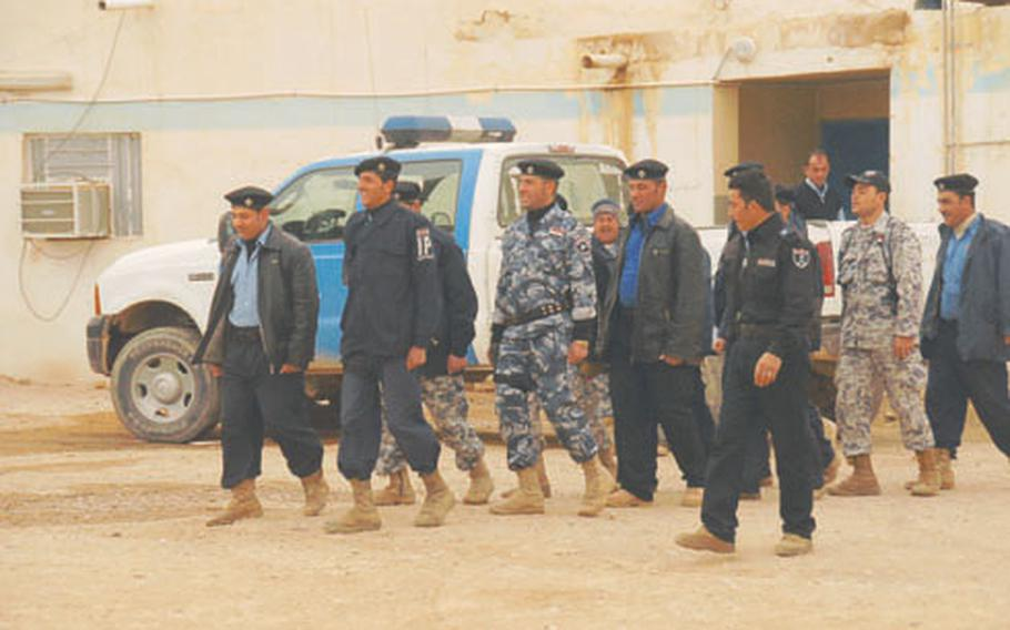 Iraqi police practice marching in their police compound, a former British fortress next to Rutbah's outdoor market.