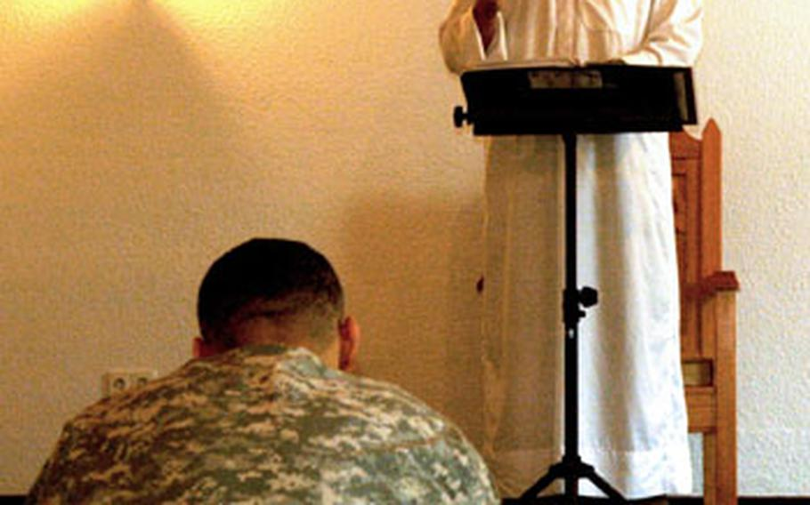Chief Warrant Officer 3 Scott Weathersby, the Muslim lay leader for the Stuttgart community, holds weekly Friday services at the Panzer Kaserne Chapel. Religious programming has doubled in the past year in Stuttgart, where Col. Thomas Preston heads a team of eight chaplains, who on any given weekend lead 10 different worship services at the garrison's three chapels.
