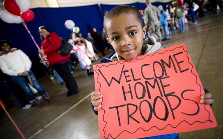 John Parker Jr., 4, displays a sign celebrating his father's return Sunday to Misawa Air Base, Japan.