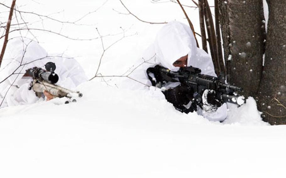 Sgt. Jeff Hubbs, left, and Pfc. Chris Sons with the Kentucky Army National Guard take part in sniper training Monday on Camp Makomanai in Sapporo, Japan.