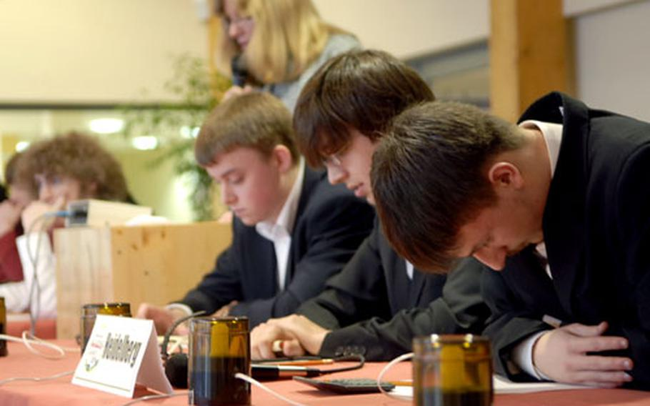 Members of the Heidelberg High School team concentrate on a question, en route to a victory over Patch High School. Team members are, from left, Randall Bryan, David Brunell and Kevin Burdge. The fourth member, Kyle Johnson, is not shown. Heidelberg, the defending champion, won the competition again.