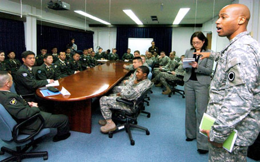 Master Sgt. Anthony Ward asks a question during a round-table discussion between Camp Zama, Japan, NCOs and members of the Japan Ground Self-Defense Force Noncommissioned Officer Association at Camp Zama on Wednesday.