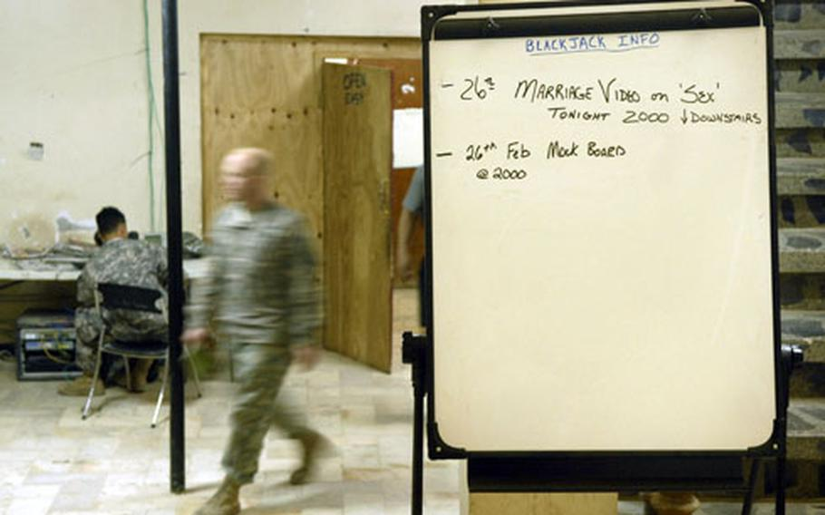 A catchy notice near the command post lets soldiers from Company B, 1st Battalion, 35th Armor Regiment, in on a marriage enrichment video that will be shown at Combat Outpost Dolby.