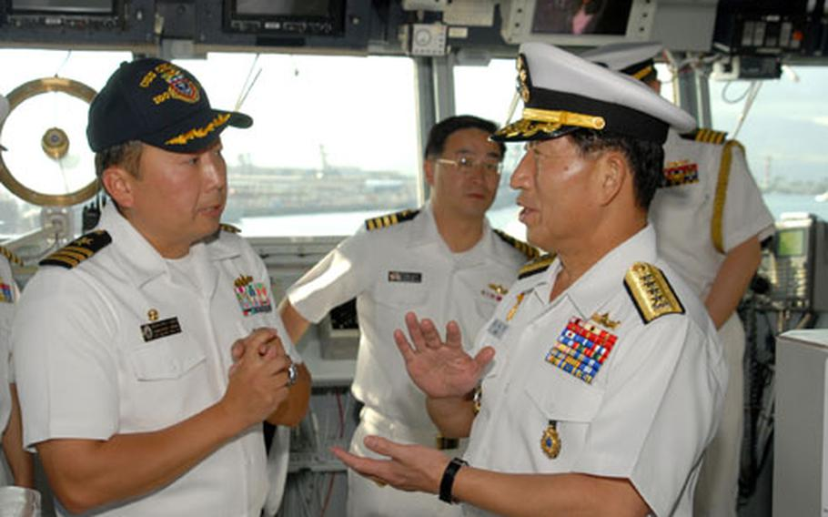 Cmdr. Heedong Choi, left, talks with South Korean Chief of Naval Operations Adm. Jung Ok-keun, right, at Pearl Harbor in January.