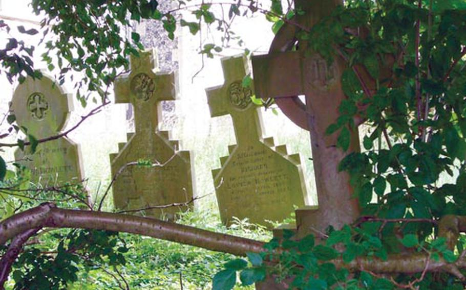 Tombstones, eerily sunken into the ground, can be seen outside the St. Mary's Church, also located on the estate.