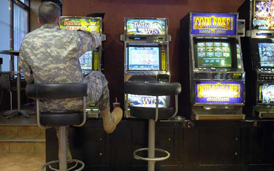 A soldier tries his luck at a slot machine at an Army base in Germany. The U.S. Army Garrison Grafenwöhr commander says that use in slot machines has increased at his bases since 172nd Infantry Brigade soldiers returned from Iraq late last year.