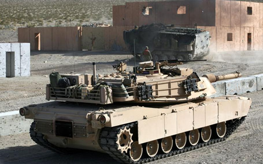 A U.S. Marine M1A1 Abrams tank from 2nd Tank Battalion attacks a target during assault training at Marine Corps Air Ground Combat Center, Twentynine Palms, Calif., in January. The Iraqi army will acquire 140 advanced American-made battle tanks with help from the U.S. military over the next 18 months.