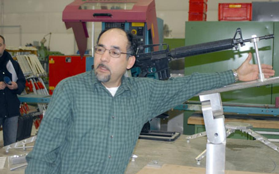 General supply specialist Robert Arbolay shows off a custom-made rifle mount at Grafenwöhr's Training Aids Production Center on Wednesday.