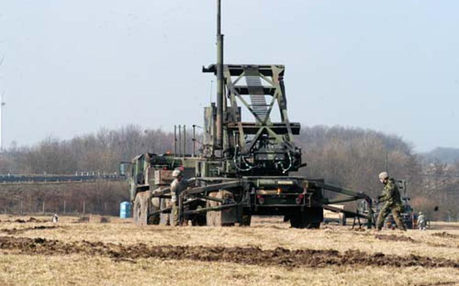 Soldiers with Battery A, of the 5-7th Air Defense Artillery, ready a Patriot missile launcher to be hauled to a new destination. The exercise was part of nearly three weeks of training conducted by the 500 soldiers in the hills near Baumholder, Germany.