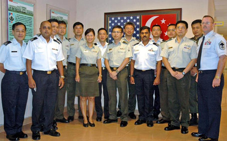 Air Force Senior Master Sgt. David Duncan, right, director of education for Kadena Air Base's Erwin Professional Military Education Center on Okinawa, stands with classmates from the Singapore Armed Forces Warrant Officer School.