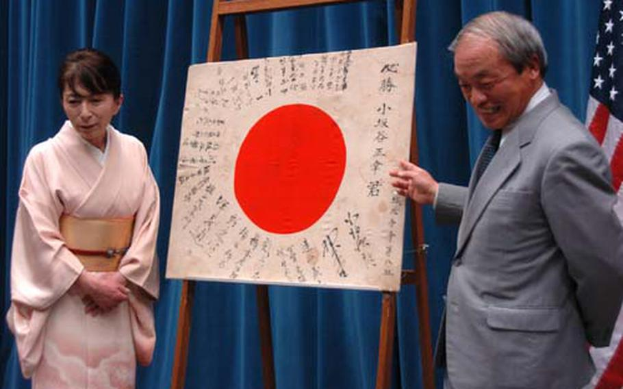 Naomi Matsufuru, left, and Yoneyuki Kosakadani share their thoughts after receiving a Japanese flag believed to have been owned by their uncle, a corporal in the Japanese Army who died during World War II. The two were among five family members to receive the flag during a ceremony at the American Embassy in Tokyo on Wednesday.