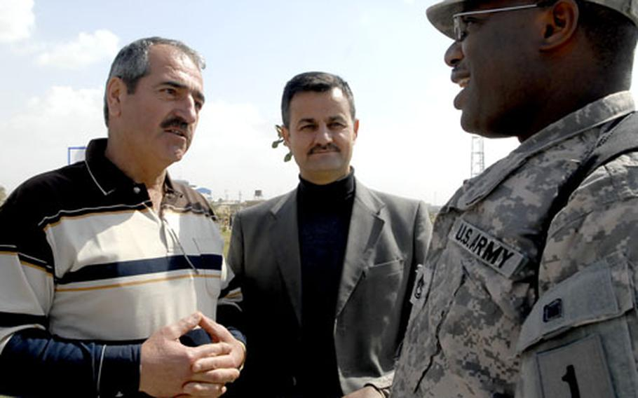 Sgt. 1st Class Octavius Brandon, right, talks to a Kurdish man who stopped him outside an Irbil festival. American troops get a much friendlier reception in Iraq's Kurdish provinces than in much of the rest of the country and most Kurds ask for more U.S. troops, rather than a speedy withdrawal.