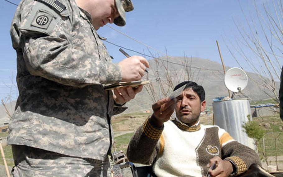 Maj. Jim Lawson, left, talks to a refugee living in Iraq's Kurdish semi-autonomous region. Lawson and other members of the 4100 Border Transition Team work on everything from training border guards to humanitarian efforts.