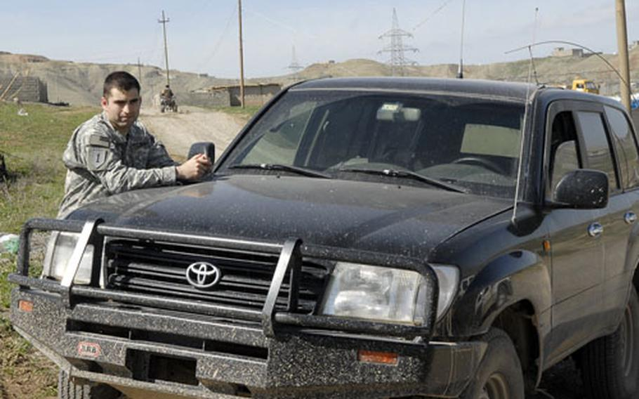First Lt. Richard Myers leans on an sport utility vehicle after a long day on the road. Myers and nine other members of the 4100 Border Transition Team are responsible for three provinces that make up Iraq's Kurdish semi-autonomous region.
