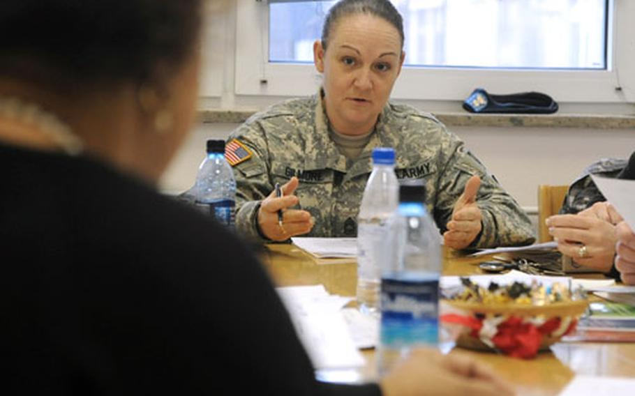 Jamie Gilmore, School Advisory Committee president at Germany's Kaiserslautern High School, right, discusses a point with Principal Jennifer Beckwith. Gilmore, whose daughter is a senior, is a master sergeant with 21st Theater Sustainment Command.