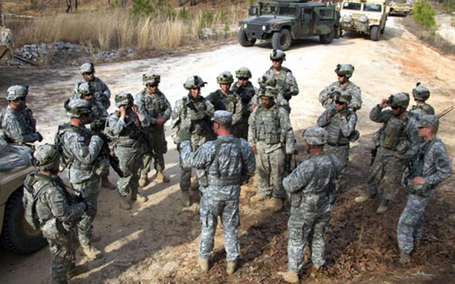 Observer controllers from the Joint Multinational Readiness Center at Hohenfels, Germany, conduct an after-action review with soldiers from the 82nd Airborne Division during an exercise at Fort Bragg, N.C. The mission was part of the exportable training system developed by the JMRC for use at a unit's home base.