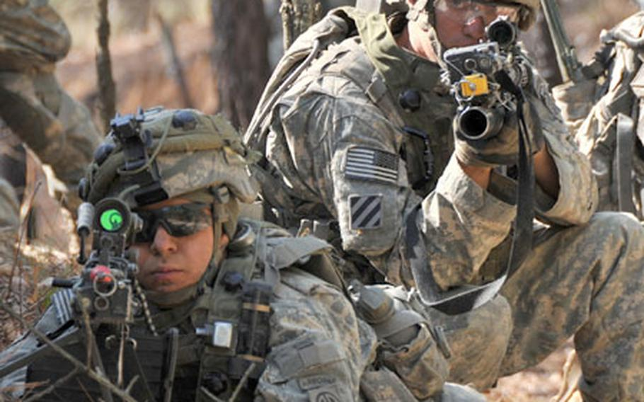 Two soldiers from Brigade Special Troops Battalion, 2nd Brigade Combat Team, 82nd Airborne Division, provide security while on a route reconnaissance mission during an exercise at Fort Bragg, N.C., with members of the the Joint Multinational Readiness Center from Hohenfels, Germany.