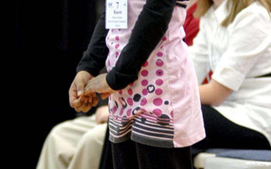 Raevin Dunson of Patrick Henry Elementary School in Heidelberg stands on her tippy-toes to reach the microphone.