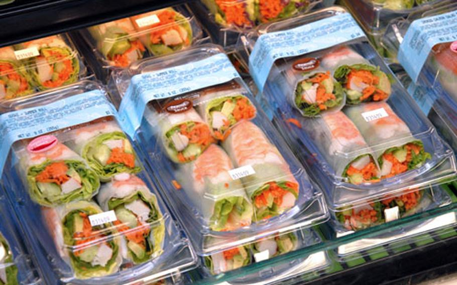 Freshly-prepared California rolls sit in the new display cases Saturday just prior to the grand opening of the sushi bar.