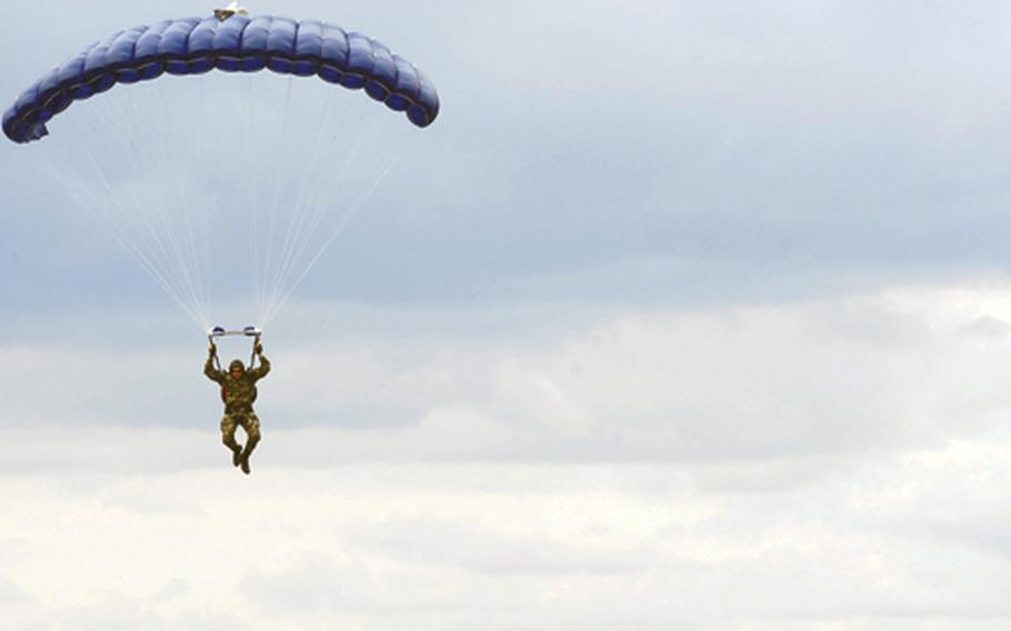 Petty Officer 1st Class James Endicott parachutes through the sky during a HALO jump near Yambol in southeastern Bulgaria.
