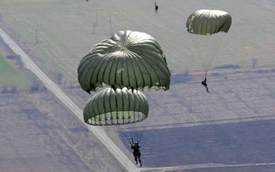 U.S. and Bulgarian paratroopers float to the ground over southeastern Bulgaria last week during Operation Thracian Spring 2009. In its third year, the exercise gives the U.S. and Bulgarian military opportunity to interact and train together. U.S. and Bulgarian paratroopers performed daytime and nighttime jumps during the exercise, getting a chance to use each other's aircraft and share techniques.