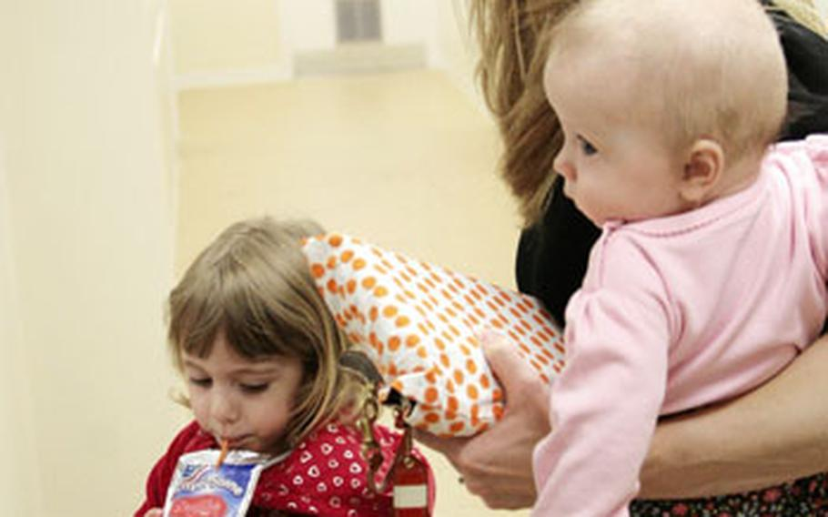 Molly Huston and her daughters Olivia, 6 months, and Lily, 3, come to the newly opened center at least three times a week, she said. Huston, who is on terminal leave with the Air Force, said the family-friendly workout room is invaluable.